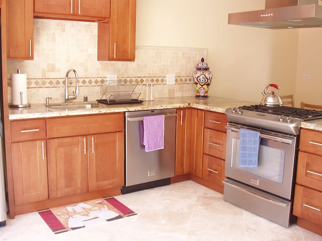 Full kitchen with dishwasher, all the dishes, cookware and small appliances you need for cooking at home