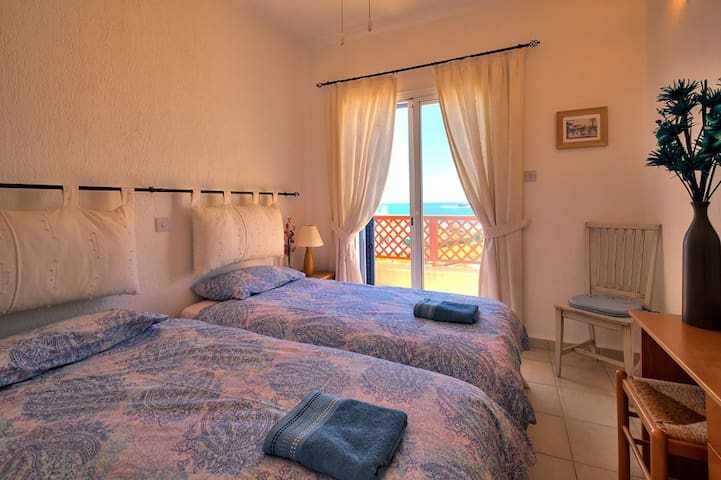 Upstairs twin room with personal balcony with a view out to sea.