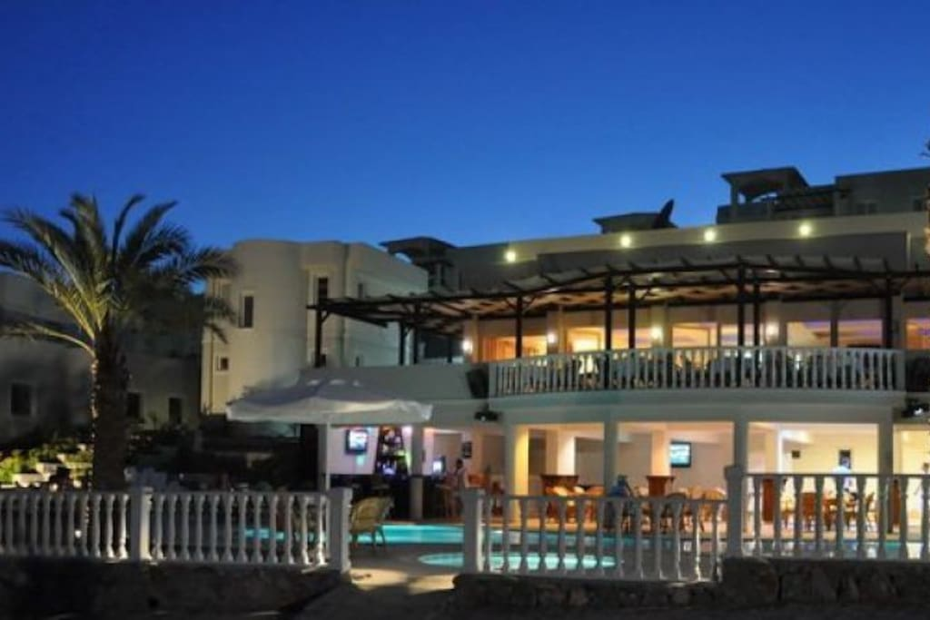 Restaurant and Pool Bar by night. Go and dine at the on-site restaurant and watch the star filled sky with views over the Flamingo golf area and neighbouring hillsides.