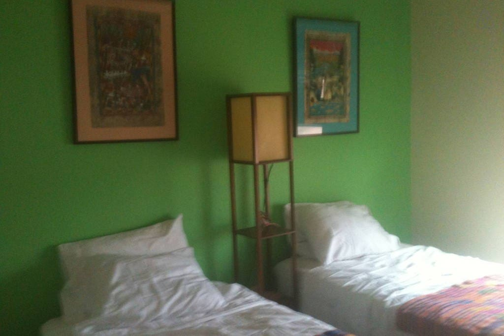 Twin bedroom with Mexican Art
