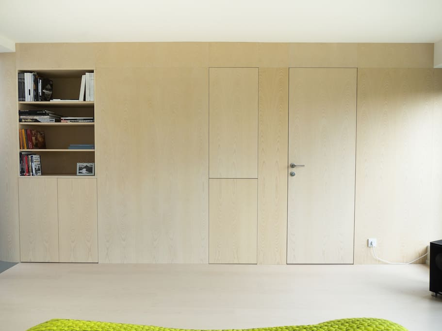 wooden wall, integrated door and wardrobe