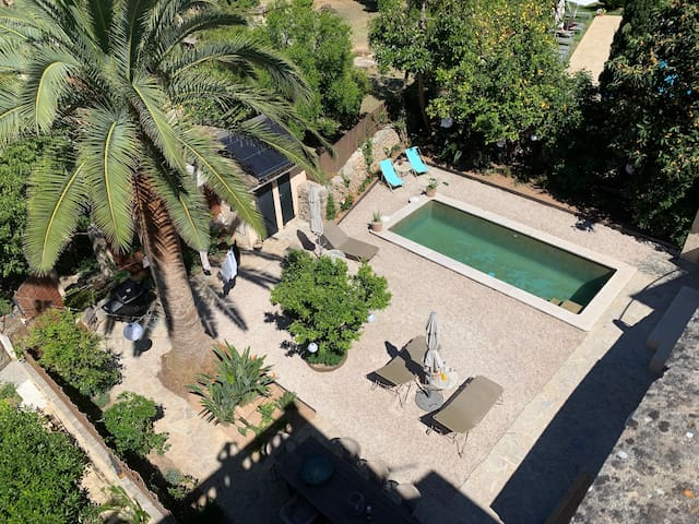 Villa / Town House with pool in the centre.