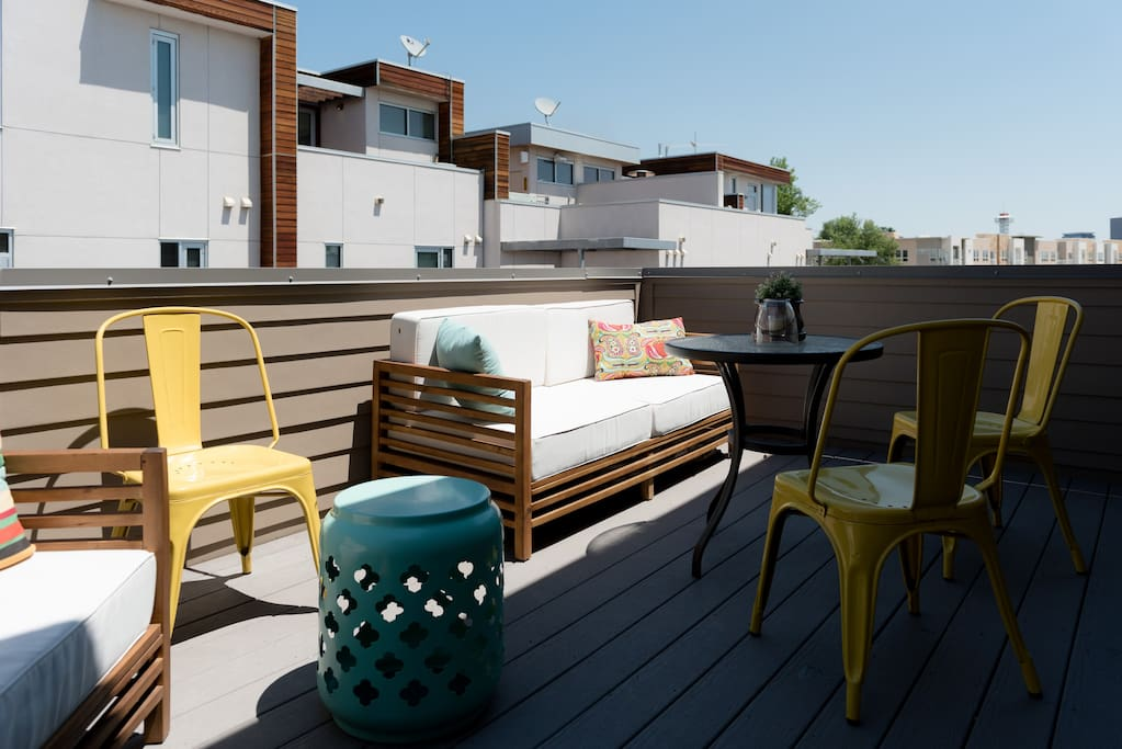 Private rooftop deck with view of the Denver skyline