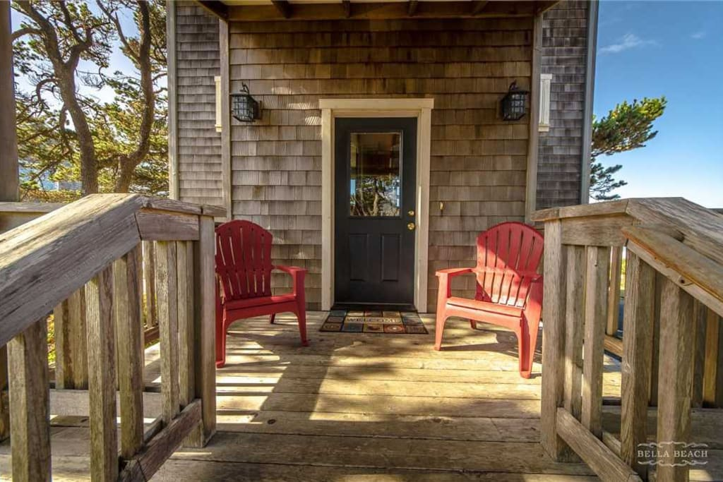 Front door with two Adirondack chairs, perfect for morning coffee in the sunlight