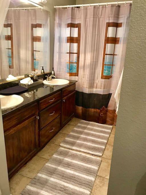 A double sink restroom, with a full size bath tub that is all yours!!