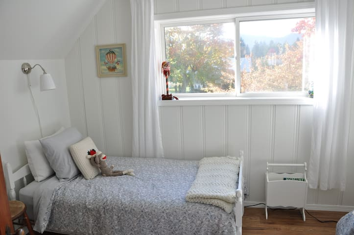Upstairs bedroom #2 featuring two single beds.