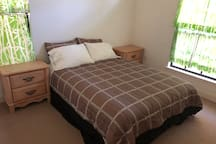 Room 3 is clear and located in the front of the house. Has a queen size bed.