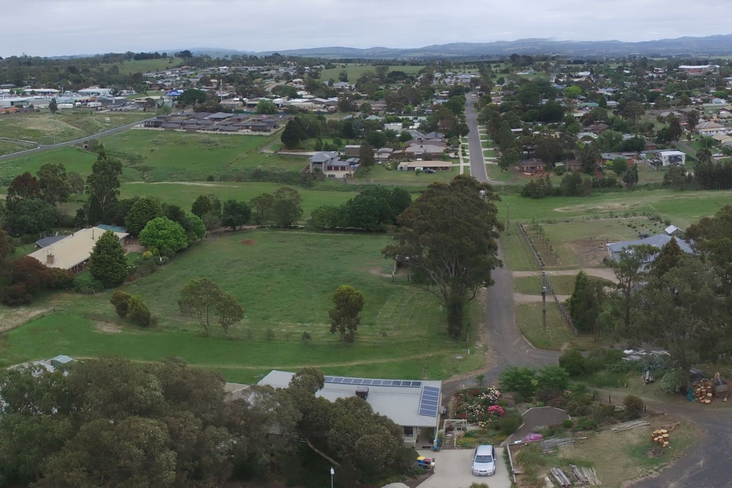 Ariel shot view , public area , other private property , Kilmore township  & Macedon ranges in the background