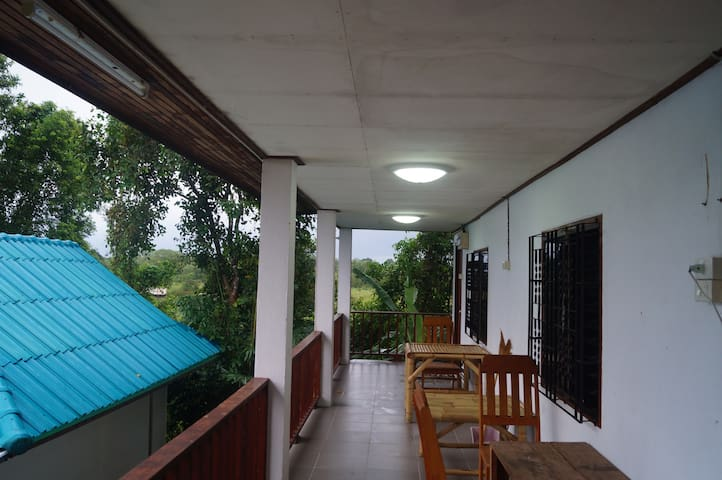 Phangan farmstay 304 Eco organic farming is the room with kitchen in side have one king size bed and good view from out side. You can see view from the beautiful lake , farm garden and mountain. On this floor have two room.