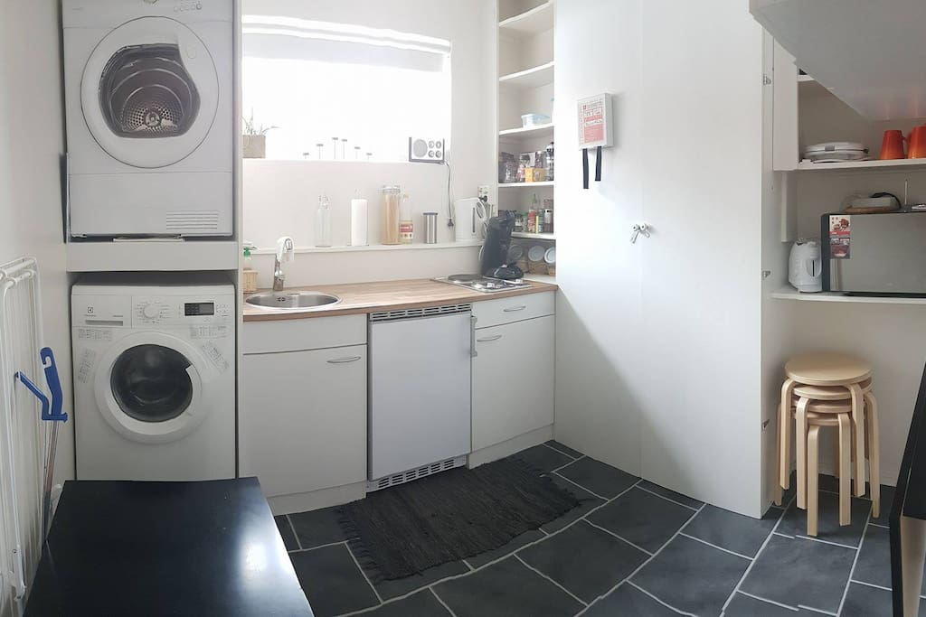 Kitchen with washing machine, dryer, refrigerator, microwave/grilloven, and more.