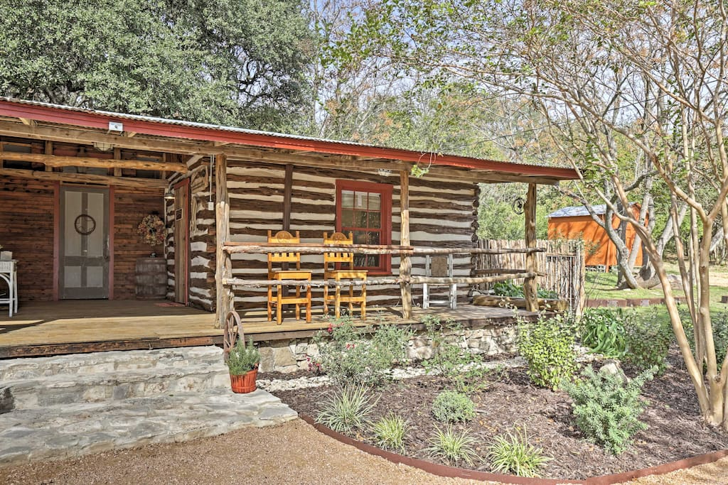 This custom cabin boasts modern comforts and showcases true Texas pride!