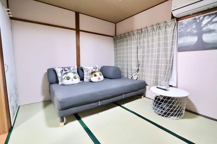 room A  with semi-double sofa bed.   this room on the ground floor  have TV and middle-size refrigerator   strong warm and cold air conditioner  can add 1 tatami