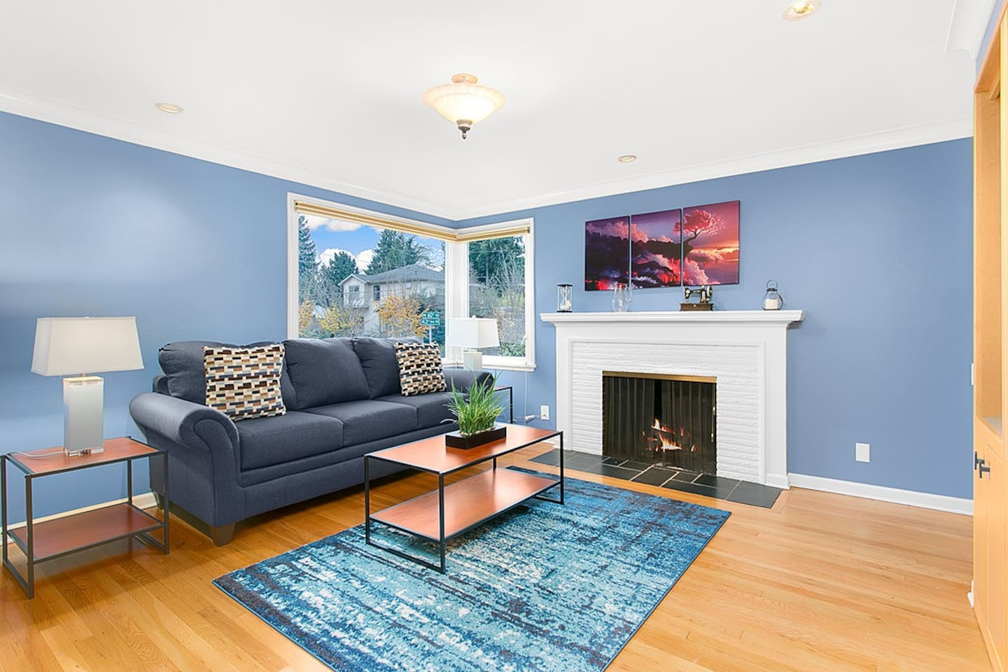 Bright and spacious living area, with a brick fire place.