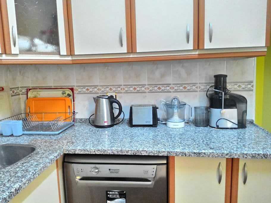 kitchen has all needed stuffs to cook or drink..