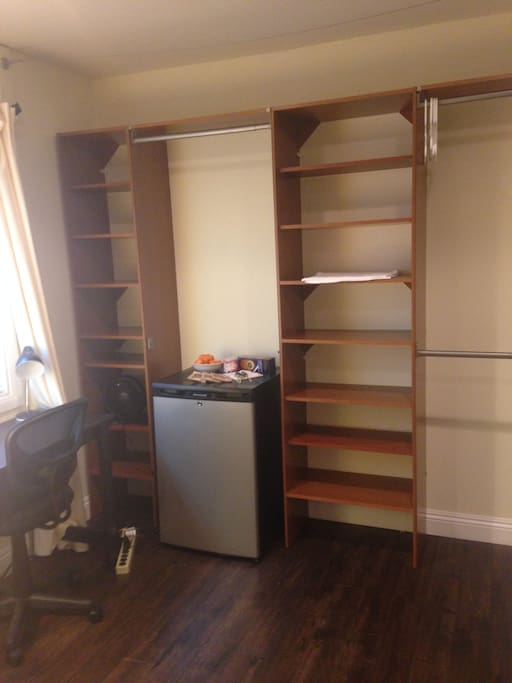 Built in shelving with refrigerator and plenty of room for your belongings