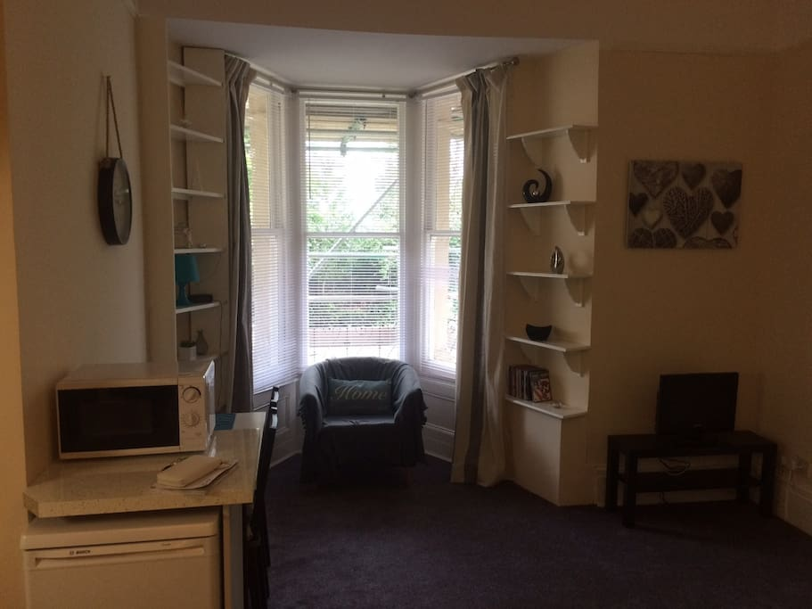 Sit in the beautiful bay window over looking the communal garden or read a book