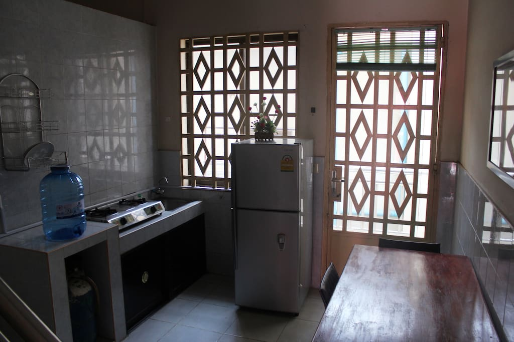 Full size refrigerator, cook top and dining table. washing machine on back deck.