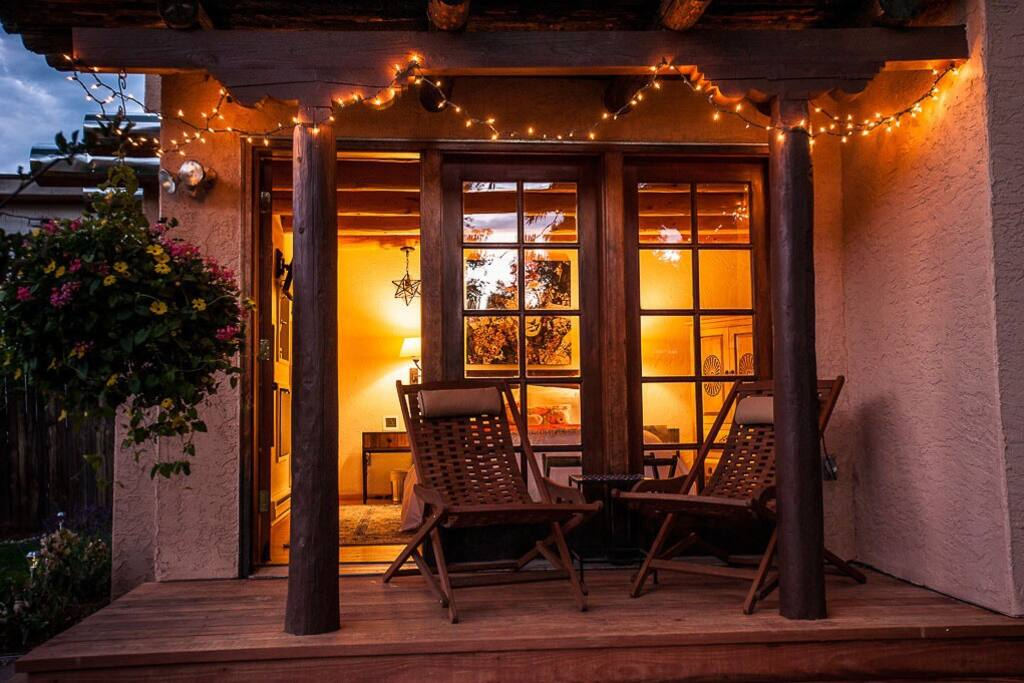 Casita porch in the evening with ambient lighting.