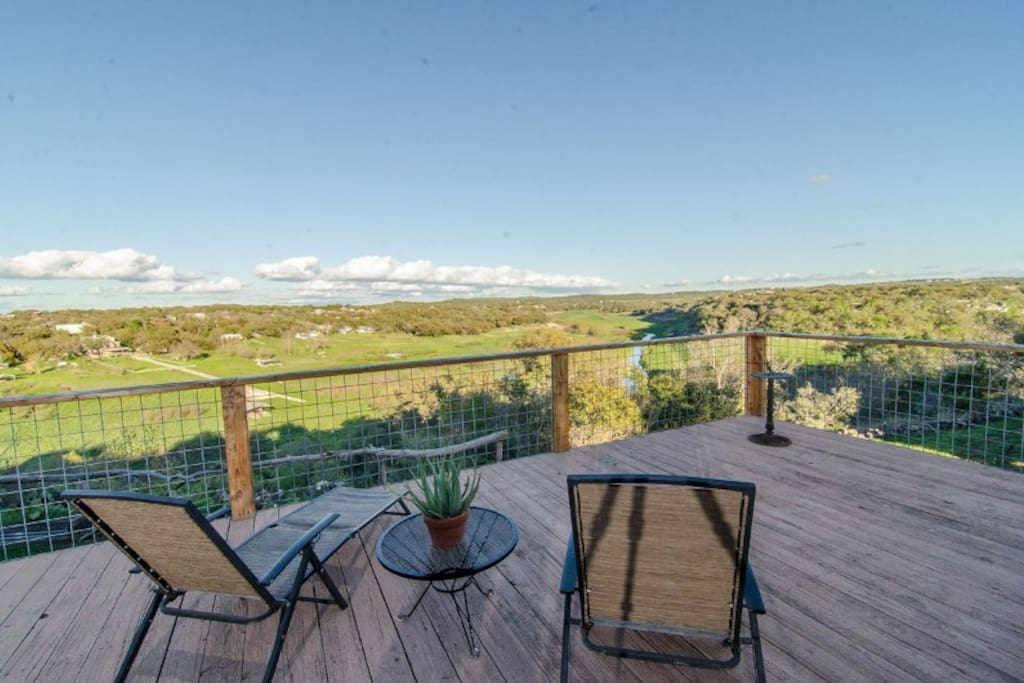 Look forward to lounging on the expansive, upper-level deck while looking out on the Pedernales River and Lake Travis.
