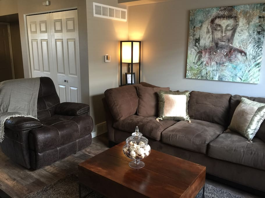 Relax in the living area on the large couch and reclining chair.