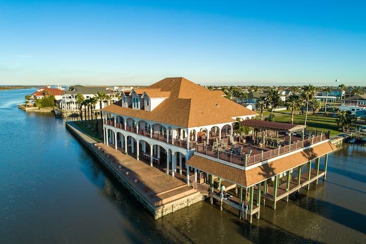 Bayfront villa w/ a large, covered deck, jet ski slips, & a pool table!