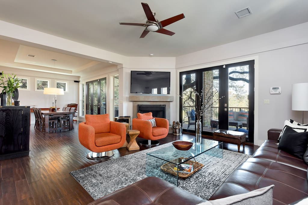Open floor plan on the main floor with a living room, dining room, gourmet kitchen and a balcony with the best view in Austin.