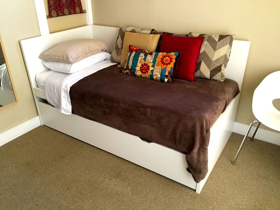 twin trundle bed can be used for one, or...