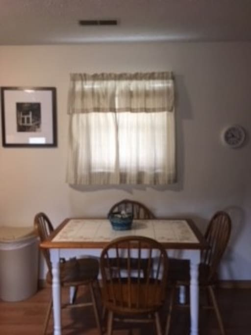 Kitchen table with 4 chairs. Additional dining table and 4 chairs on screened in porch.