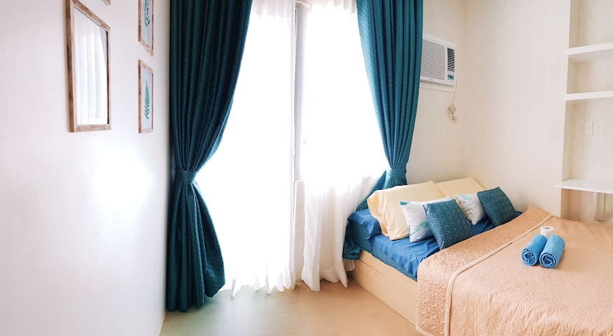 Bed leading to balcony. Aircon