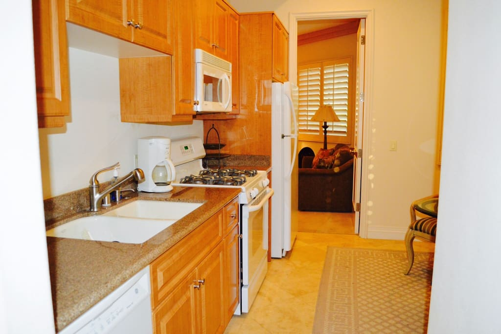 Kitchen: Stove, full size refrigerator, dish washer, sink, microwave, coffee maker, toaster and equipped kitchen.