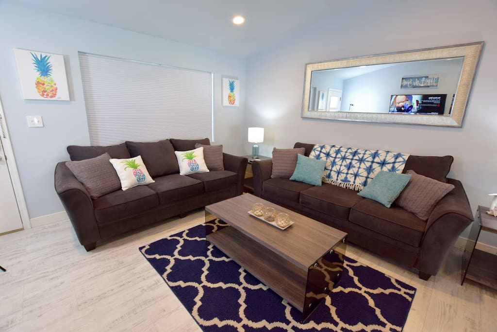 Living room with one sofa bed with memory foam queen mattress. Comes with linens and blankets.