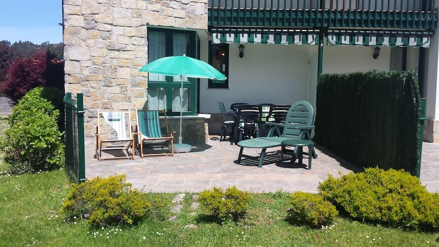 Precioso apartamento con jardín y garaje.