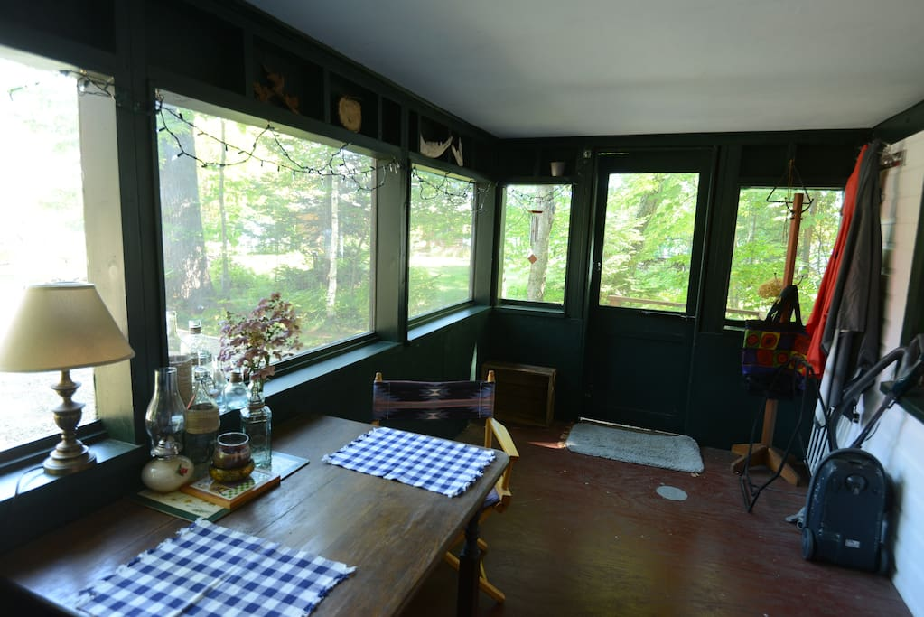 Screened porch that is enclosed in colder weather.