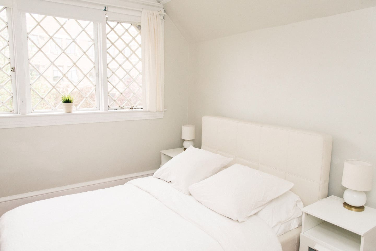 Clean white room with great windows and natural light