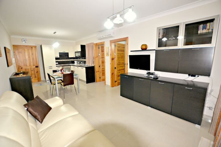Spacious Open Plan Living/Dining Area (air-conditioned)