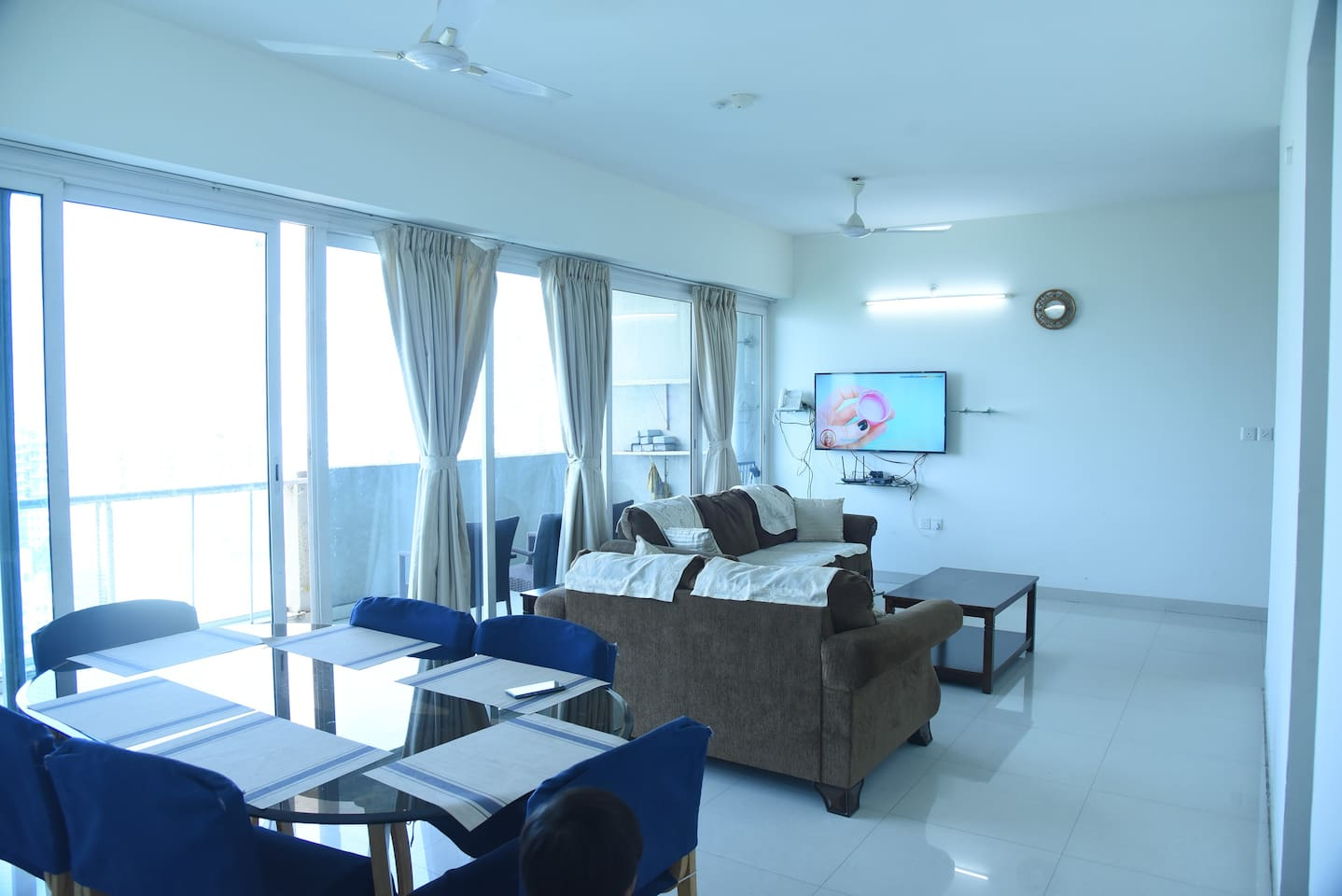 Living room with 55' TV and comfortable seating with skyline views provide ample space to enjoy the stay from 16th floor