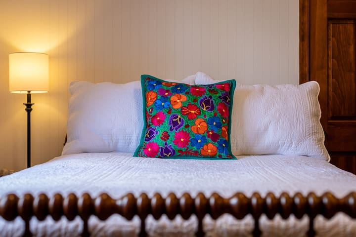 Full-size bed in La Selva Room
