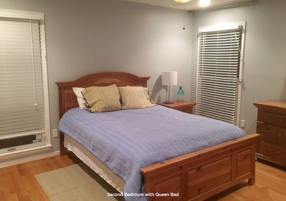 Queen bed in quaint bedroom.