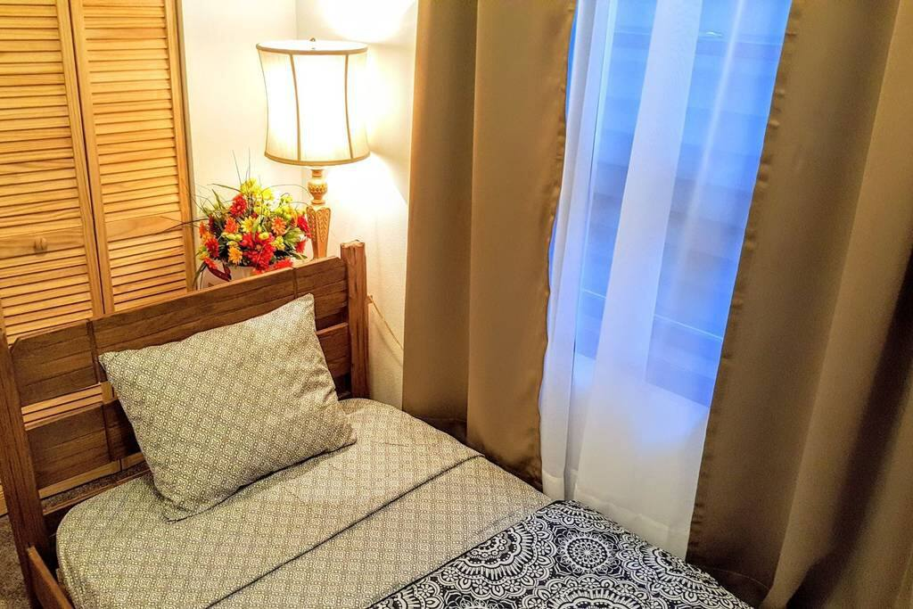 This is exactly how you will find your bedroom upon checking in. Sheets, blanket and towels are provided. Mattress is BEAUTYREST.