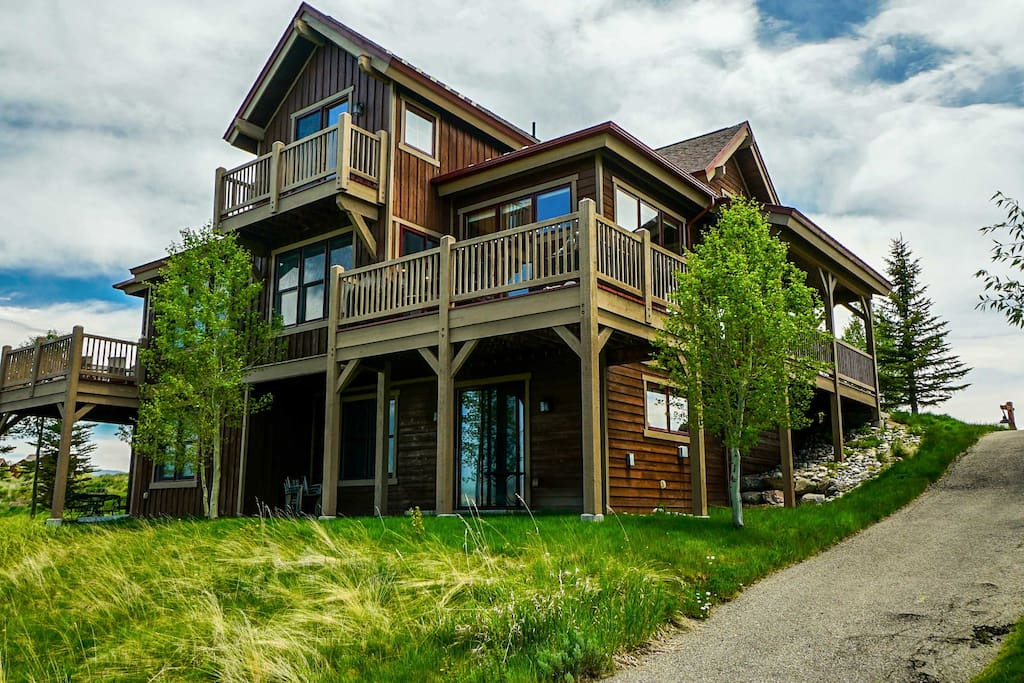 This duplex-style home boasts unobstructed views across the Grand Elk fairway!