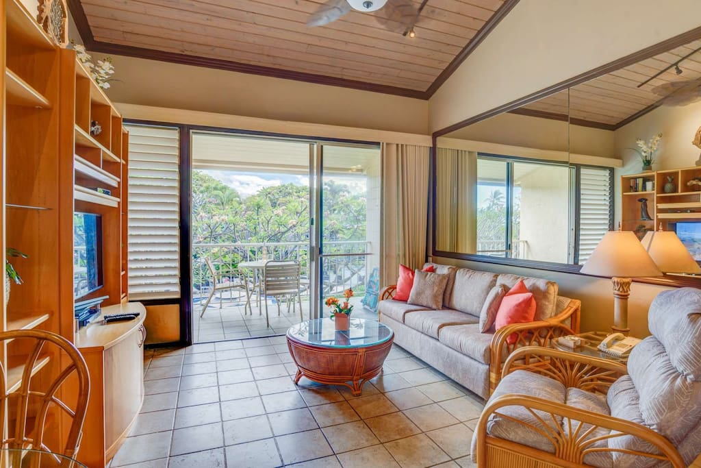 Tastefully decorated in island themed decor - spacious, bright with tile flooring through out the condo