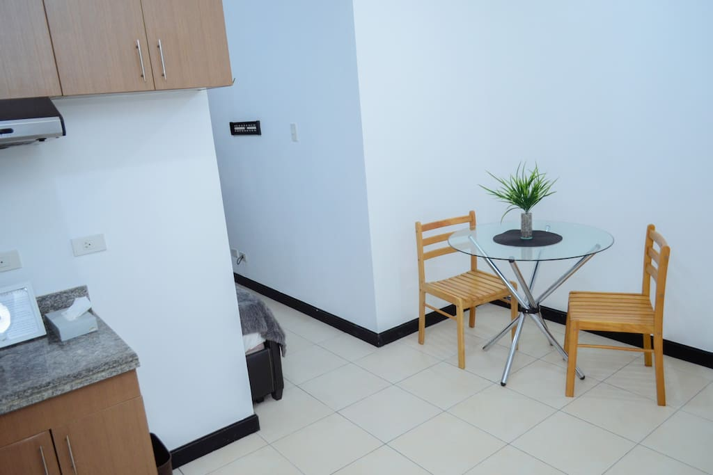 Across the kitchen is a small dining area