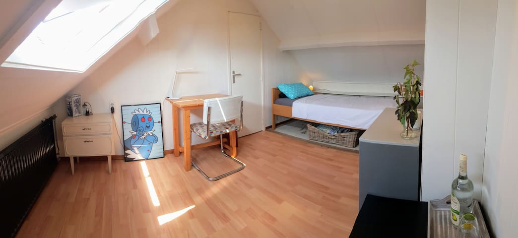Single bed in attic room near airport