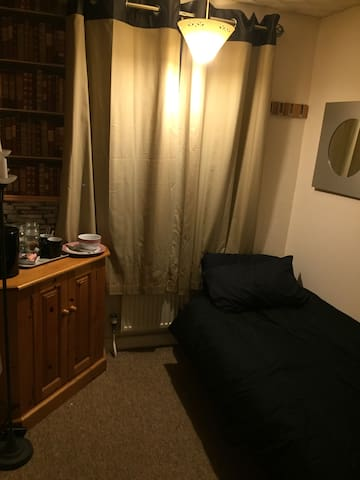 Comfortable single electric bed in this room for those wanting a place to stay in a low budget room.