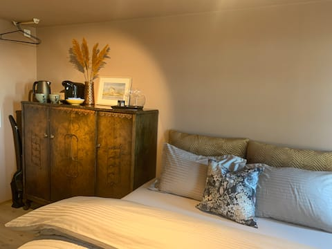 Newly refurbished bedroom/apartment with its own entrance and bathroom.
