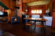 Fireplace to keep you warm on the chilly nights. Plus a small but mighty kitchen!