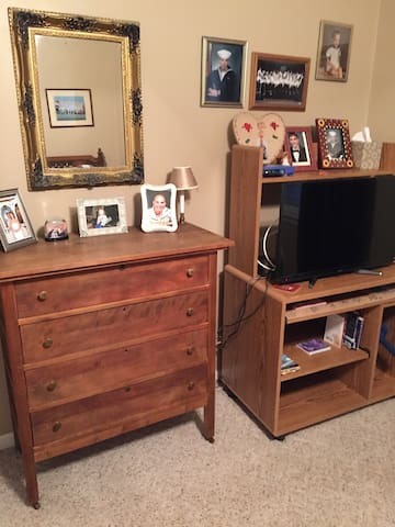 Chest of drawers and new TV with WiFi with a twin bed.