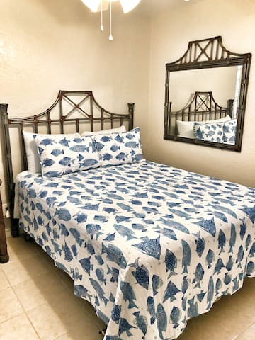 This is one of the bedrooms we call The Blue Room. This is also a pillow top queen bed.