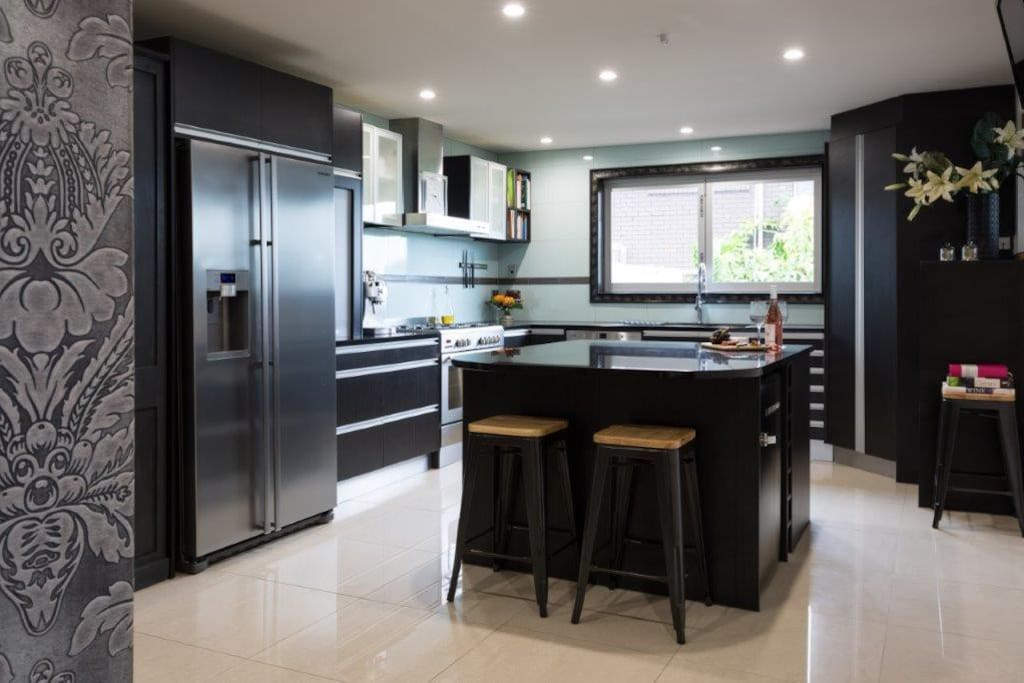 Kitchen with gas hob, ice maker fridge