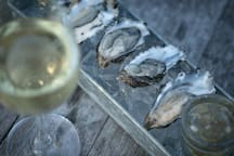 Hog Island Oysters, smoked fennel mignonette, and a crisp white at the Tell.